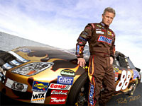 ricky rudd next to his car